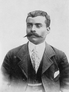 """Emiliano Zapata, 1914"" by Unknown photographer - Blurpeacehttp://www.barriozona.com/emiliano_zapata_in_the_name_of_the_land.html. Licensed under Public Domain via Wikimedia Commons -"